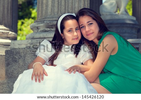 Two sisters Smiling in the First Communion Day - stock photo