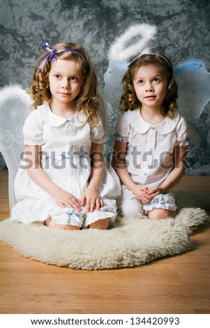 two sisters with angel wings