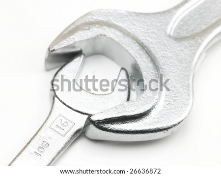 Two sizes of spanners in white background - stock photo