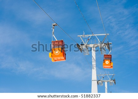 Two ski lift cable cars - stock photo