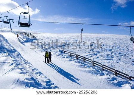 two skiing people in a skilift