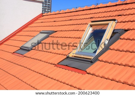 Two skylights fitted to the roof of burnt roofing - stock photo
