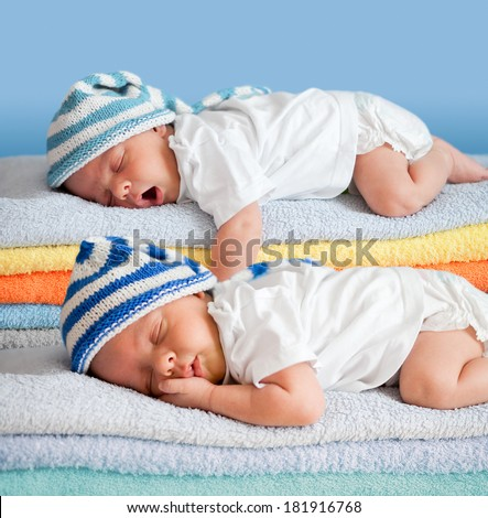 Two sleeping babies - stock photo