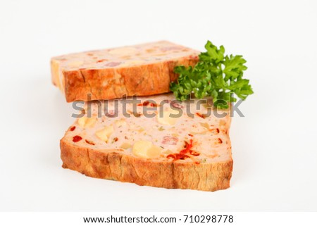 two slice of meatloaf with white background
