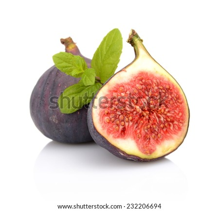 Two sliced figs lengthwise in half with mint, isolated on white background - stock photo