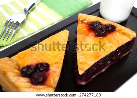Two slices of delicious homemade cherry pie on wood tray - stock photo