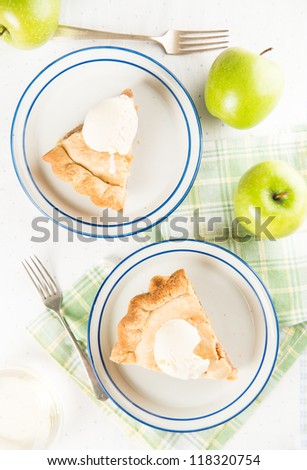 Two Slices of Fresh Homemade Apple Pie with Scoop of Ice Cream - stock photo