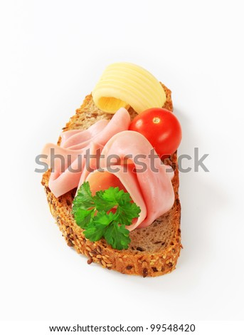 Two slices of ham on wholegrain bread