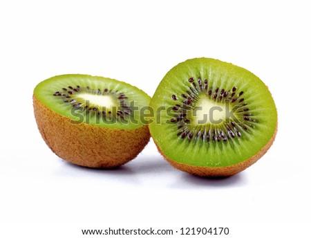 Two slices of kiwi fruit isolated on white background - stock photo