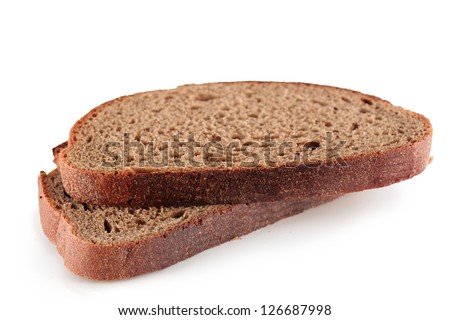 Two slices of rye bread on a white background. - stock photo