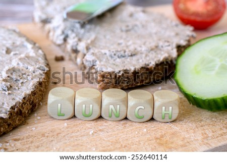 Two Slices Of Wholemeal Bread With Spread And Cucumber - stock photo
