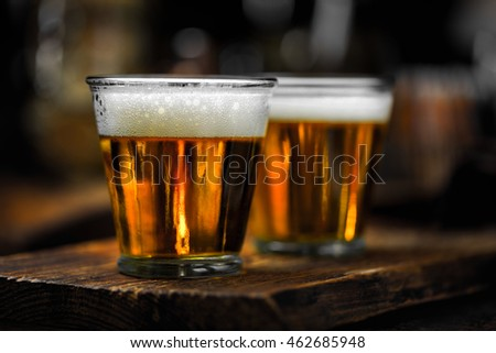 two small beers in recycled glasses
