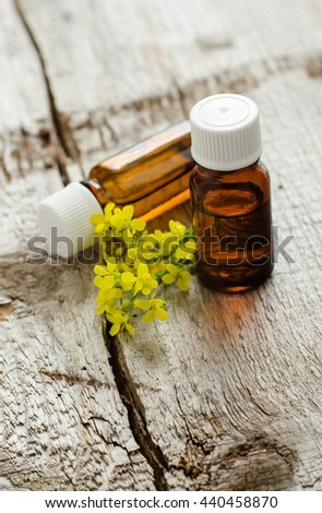 Two small bottles of natural cosmetic (essential) aroma oil - stock photo
