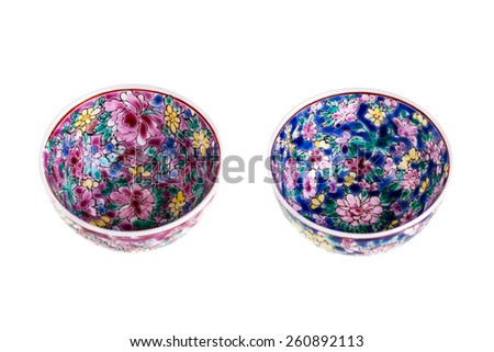 two small chinese soup bowls isolated over a white background