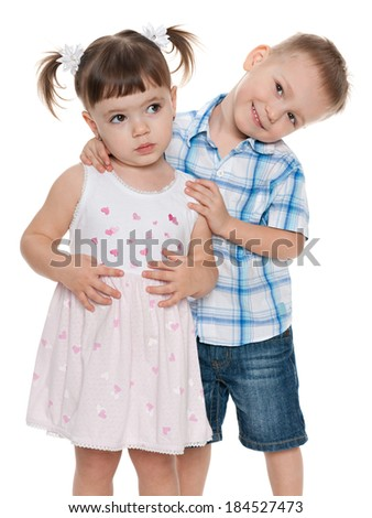 Two small fashion children together on the white background