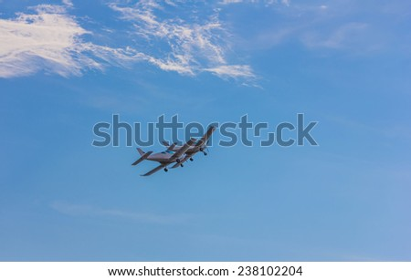 Two small flying aircraft in a blue sky - stock photo