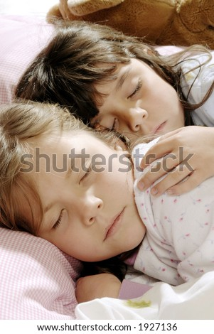 two small girls sleeping together - stock photo