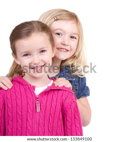 Two small girls smiling on an isolated white background