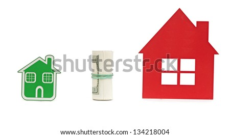 two small house and dollar bills. Business exchange with money and house - stock photo