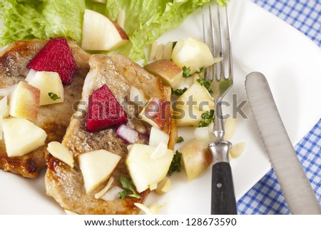 Two small minute steaks with fresh apple salad on a plate