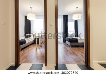 Two small, modern sleeping rooms interior design in scandinavian style - stock photo