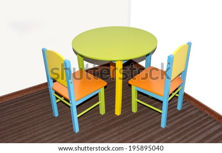 two small school chairs and table in fresh green blue and red - stock photo