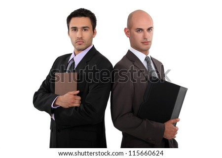 Two smart businessmen - stock photo