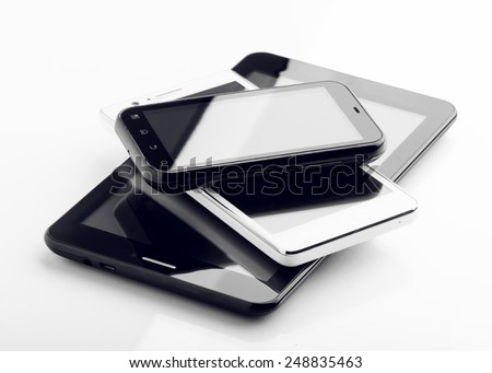 Two Smart Phones And Tablet Isolated On White
