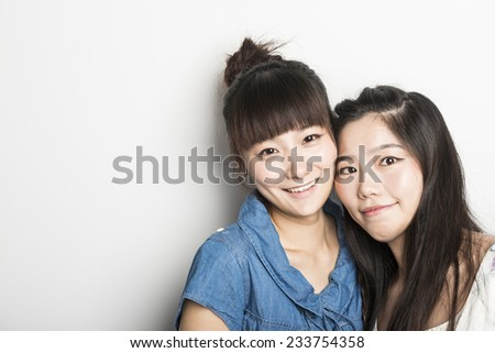 Two smiling asian girls,isolated on white background