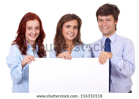 Two smiling attractive businesswomen with handsome businessman holding white board, isolated on white - stock photo