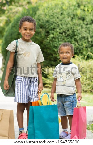 Two smiling boys after-shopping. - stock photo
