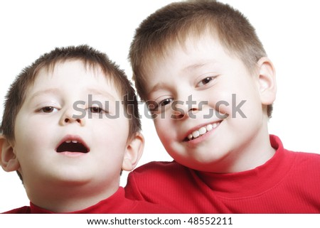 Two smiling brothers in red sweaters against white background