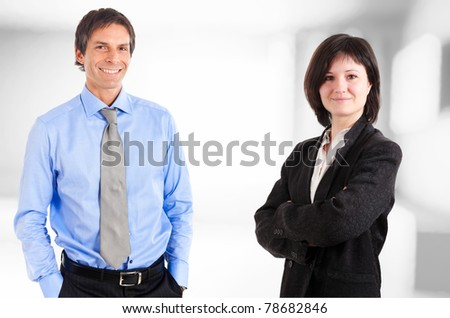 Two smiling business partners - stock photo