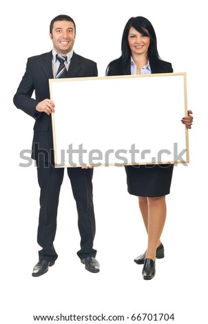 Two smiling business people holding blank banner isolated on white background