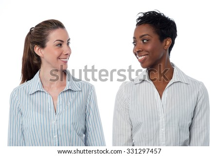 Two smiling business women isolated on white