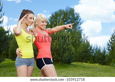 Two smiling fitness girls outdoor