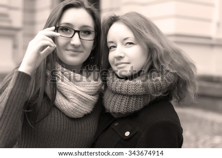Two smiling girls  in sepia tone