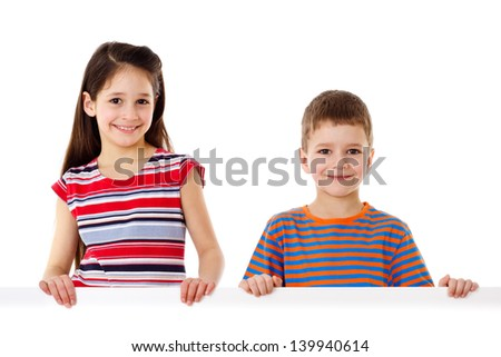 Two smiling kids standing with empty horizontal blank in hands, isolated on white - stock photo