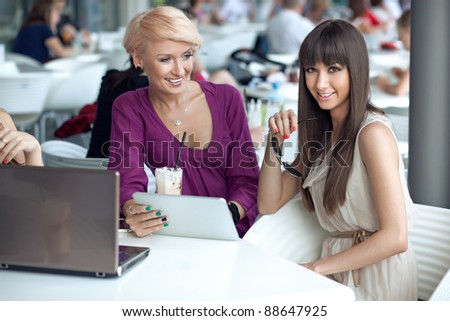 Two smiling women in a restaurant