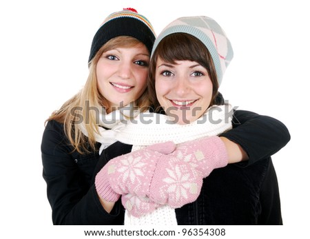 two smiling women in winter clothes