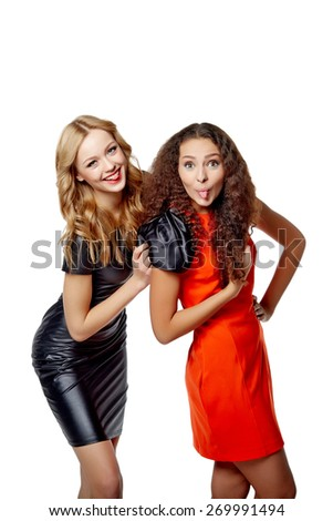 Two smiling young females friends hugging, isolated on white background - stock photo