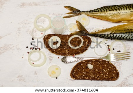 Two smoked mackerels with rye bread and onion  on white painted background  - stock photo