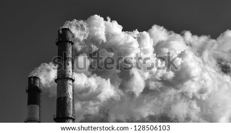 Two smoking towers. Black and white photo.