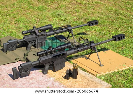 Two sniper rifles .50 BMG caliber on shooting range. With .50 BMG cal. (Browning Machine Gun) was made second longest kill in military history at 2,430 meters (2,657 yards) during the Afghanistan War. - stock photo