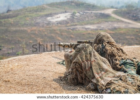 Two snipers in camouflage suits on the ground - stock photo