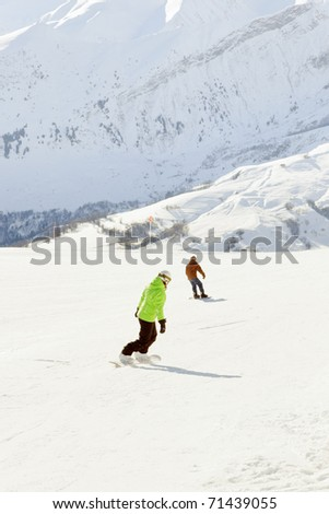 Two snowboarders in winter snow mountain landscape. France. Alps. - stock photo