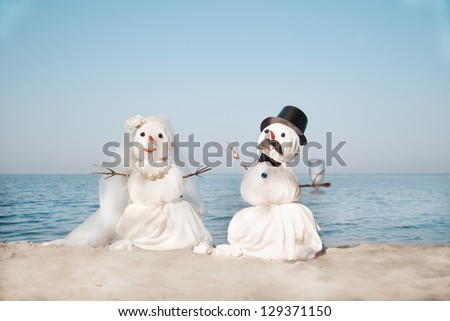 Two Snowmen - A lovely couple at the sea - stock photo