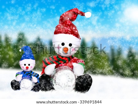 Two snowmen in the winter in nature - stock photo