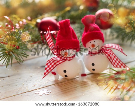 Two snowmen on holiday background, selective focus - stock photo