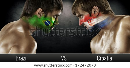 Two soccer fans with flags face to face. Brazil and Croatia, World Cup 2014 - stock photo